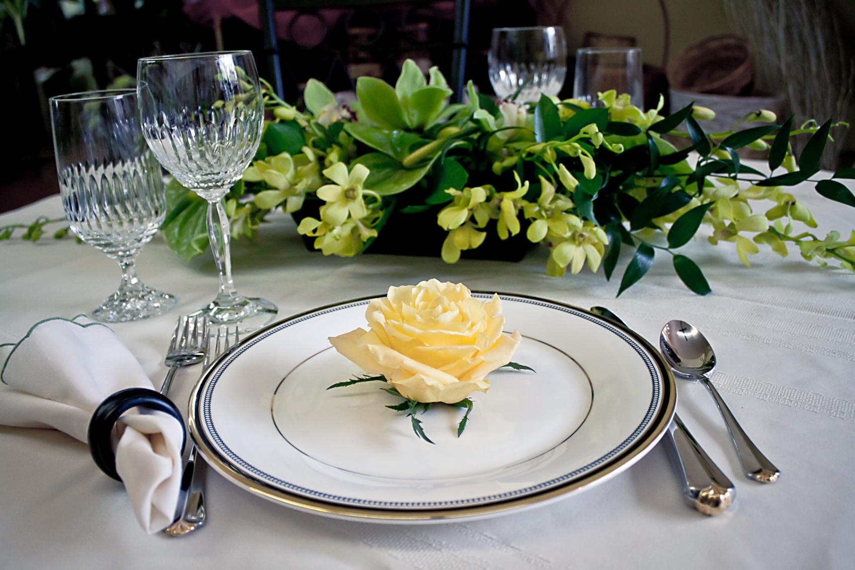 table setting with yellow rose